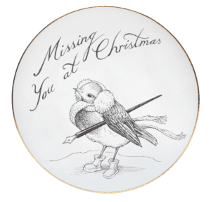 Black and white italic writing saying Missing You at Christmas with a robin holding a quill.